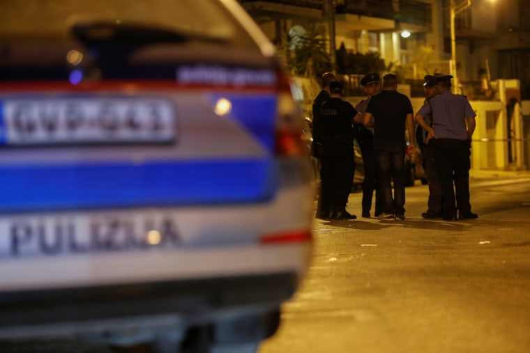 Image: Police officers stand near the home of Melvin Theuma, who had been granted a presidential pardon to testify against the alleged mastermind behind the assassination of anti-corruption journalist Daphne Caruana Galizia, in Swieqi