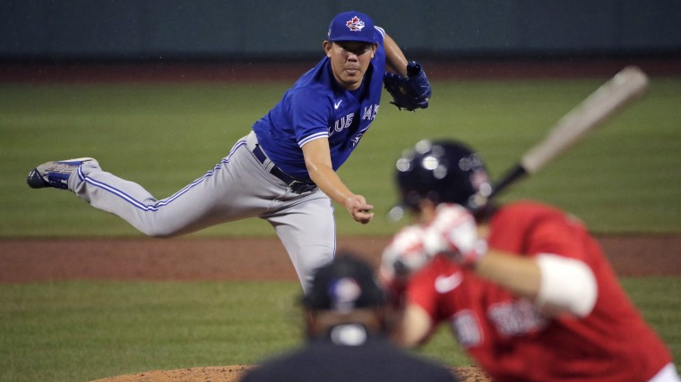 Image: Toronto Blue Jays pitcher Shun Yamaguchi delivers during the fourth inning of an exhibition baseball game against the Boston Red Sox