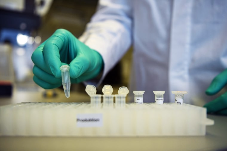 Image: FILE PHOTO: Employee Philipp Hoffmann, of German biopharmaceutical company CureVac, demonstrates research workflow on a vaccine for the coronavirus (COVID-19) disease at a laboratory in Tuebingen