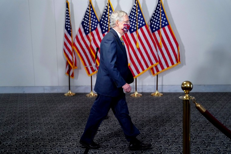 Image: Senate Majority Leader McConnell arrives to a luncheon on Capitol Hill in Washington