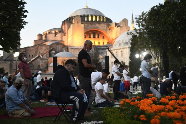 Image: Muslims offer their prayers outside the Byzantine-era Hagia Sophia, in the historic Sultanahmet district of Istanbul.