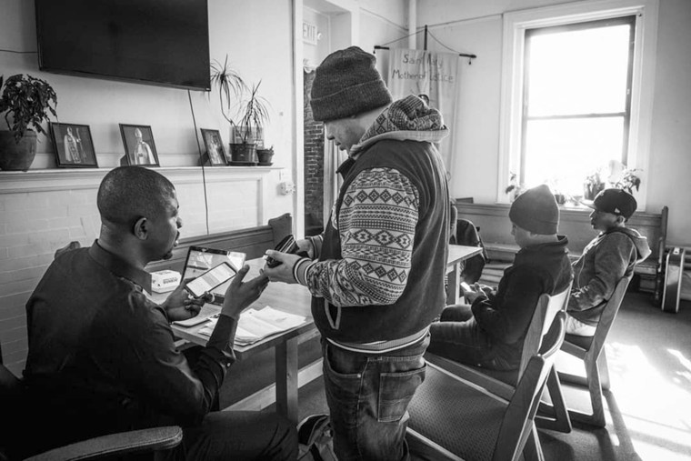 Image: Edafe Okporo and Juan, a guest at the shelter for asylum seekers in New York City.