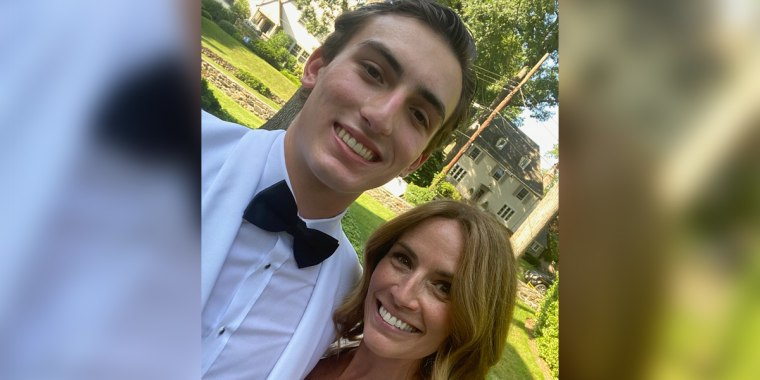 Alexis Glick with her son, Logan, who graduated from high school this week. Due to the coronavirus pandemic, his first semester of college will be remote.