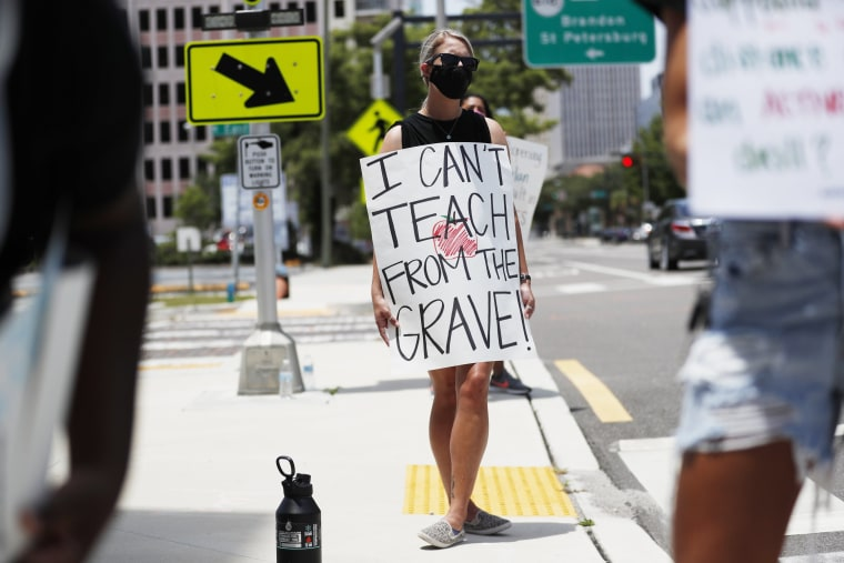 Image: Middle school teacher Brittany Myers, protests in front of the Hillsborough County Schools District Office