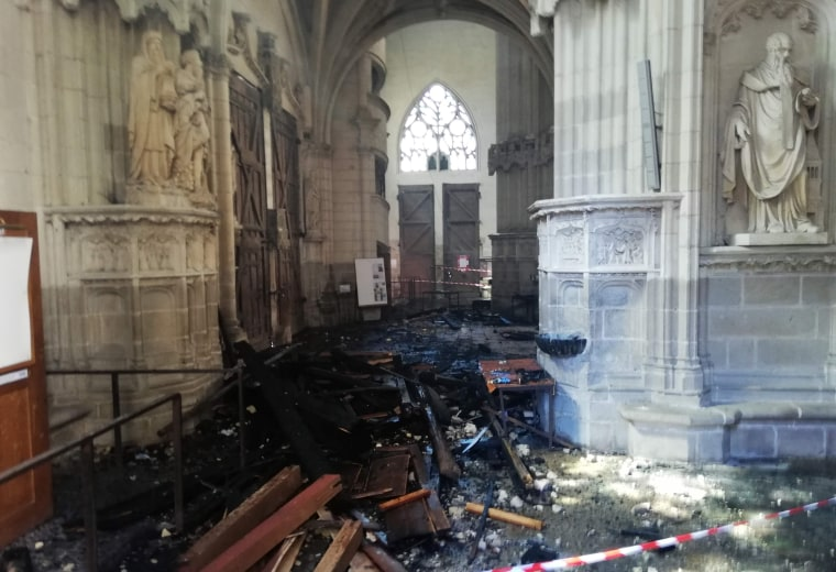 The remains of the burnt organ after it fell falling from the first floor during a fire inside the Saint-Pierre-et-Saint-Paul Cathedral on July 18.