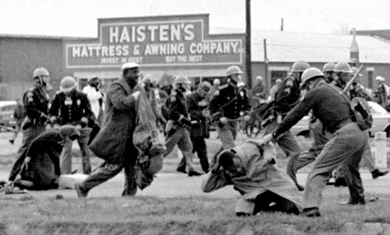 Image: Alabama state troopers swing nightsticks to break up a civil rights voting march