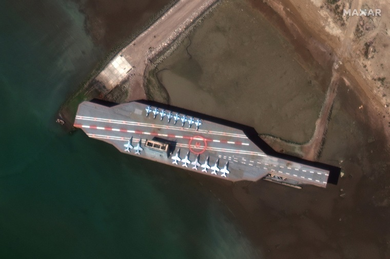 Image: Iran's refurbished mockup aircraft carrier is seen at its home port of Bandar Abbas in February, 2020.