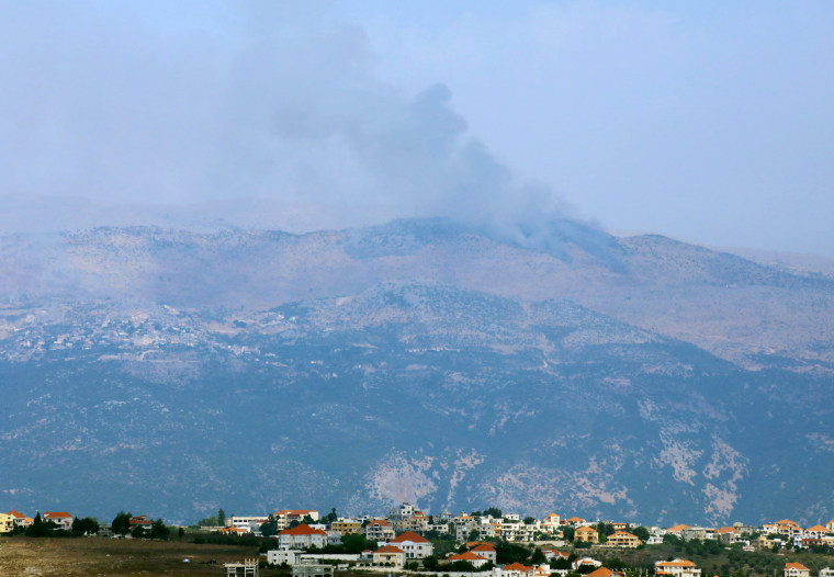 Image: Smoke rises from the disputed Shebaa Farms area as seen from Marjayoun village