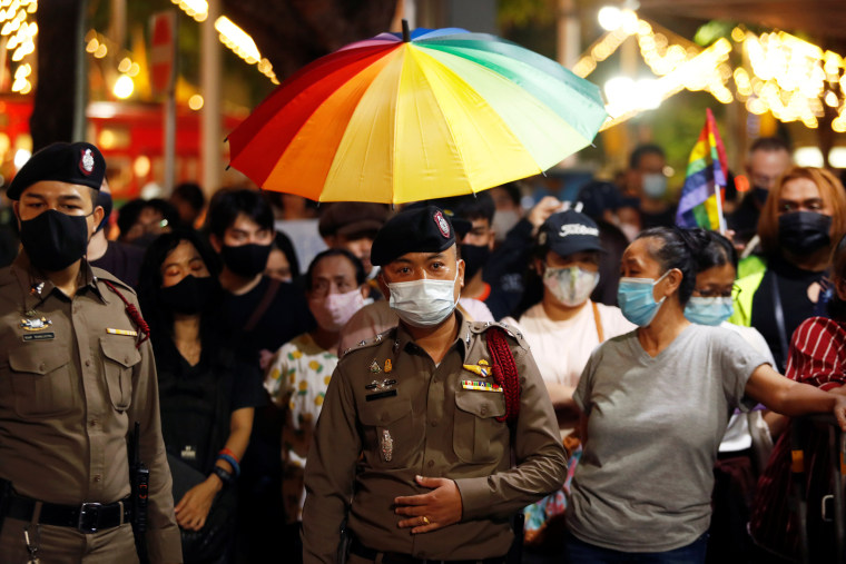 Image: Demonstrators hold a rainbow flag umbrella during a protest demanding the resignation of Thailand's Prime Minister Prayuth Chan-o-cha