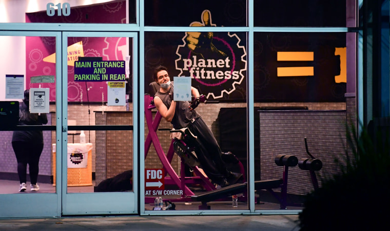 People work out at a Planet Fitness gym in Alhambra, Calif., on June 24, 2020.