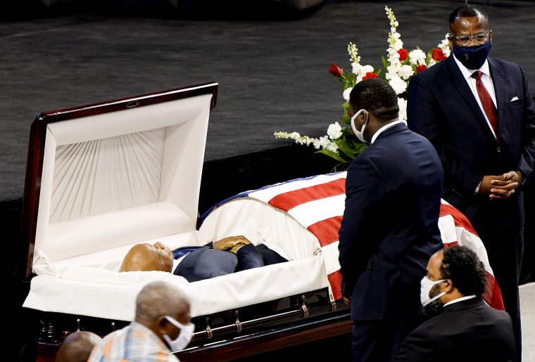 Image: People pay their respects as the late U.S. Congressman John Lewis, a pioneer of the civil rights movement and long-time member of the U.S. House of Representatives who died July 17, lies in repose at Troy University's Trojan Arena in Troy