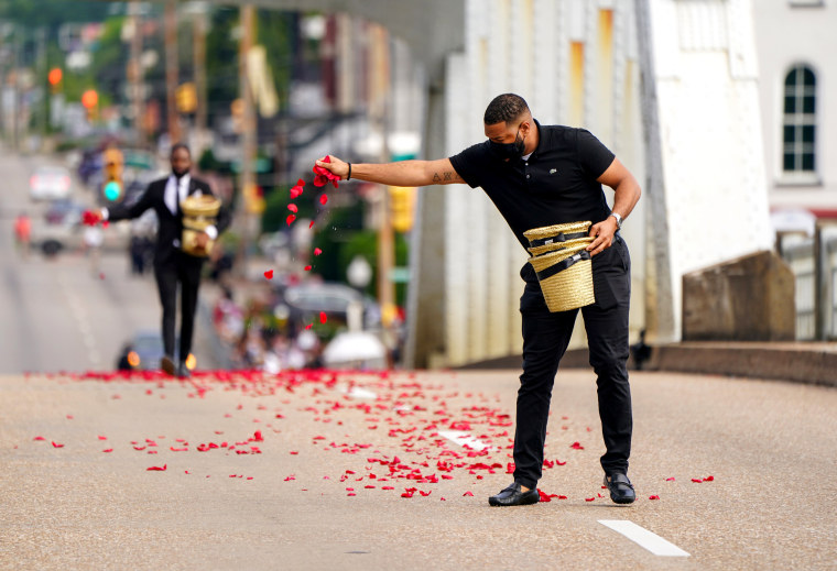 Image: Men from the Willie Watkins Funeral Home scatter rose petals representing the blood spilled on Bloody Sunday on the Edmund Pettus Bridge, in Selma