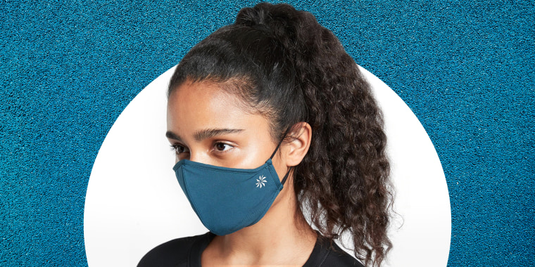 Woman wearing Athleta Made to Move face mask.