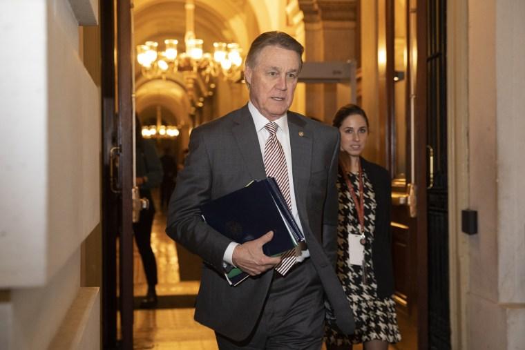 Sen. David Perdue, R-Ga., leaves Capitol Hill on Jan. 31, 2020.