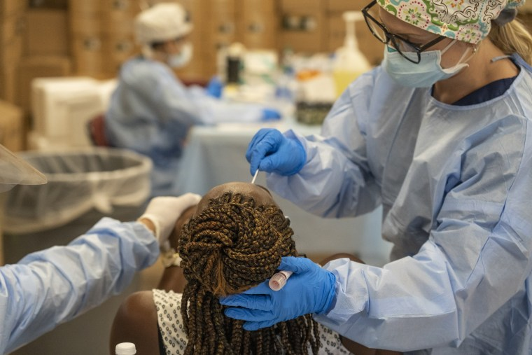 Medical workers from New York test for the coronavirus disease (COVID-19) at a temporary testing site in Houston on July 17, 2020.