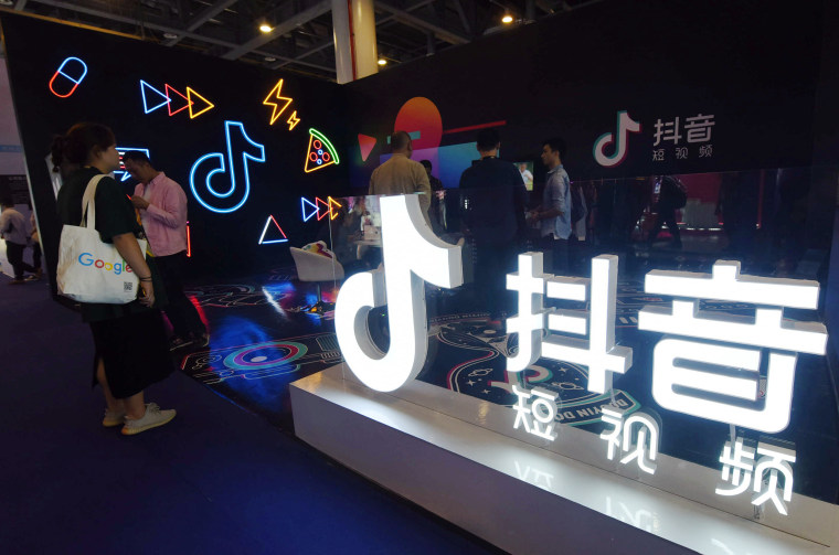 Attendees visit the TikTok stand at The First International Artificial Products Expo Hangzhou in China on Oct. 18, 2019.