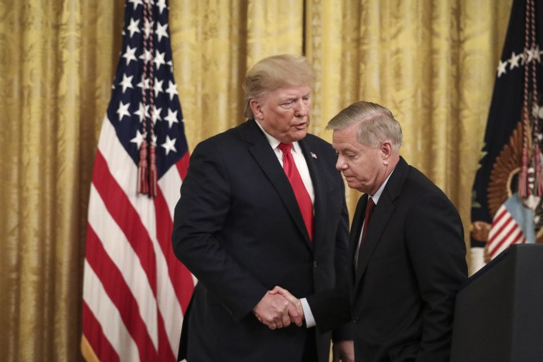 President Donald Trump shakes hands with Sen. Lindsey Graham, R-S.C., during an event at the White House on Nov. 6, 2019.