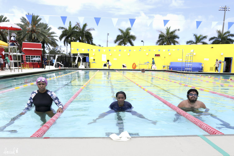 Ghenete Wright Muir, Masai Muir and Niki Lopez back in the pool at Joseph C. Carter Park for the swim-in protest.
