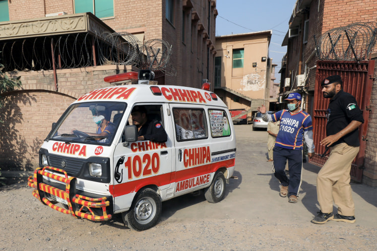 Image: An ambulance moves out of the Khyber Medical College (KMC) morgue, in Peshawar