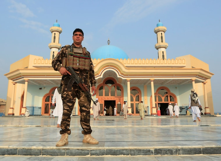 Image: An Afghan security force stands guard outside a mosque before prayers during the Muslim festival of Eid al-Adha, amid the spread of the coronavirus disease (COVID-19), in Jalalabad