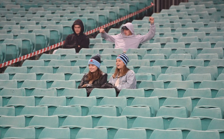 Spectators observe social distancing as they watch a rugby match in Sydney on July 11, 2020.