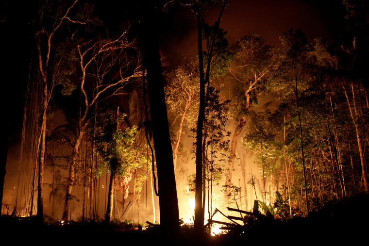 A fire burns a tract of Amazon jungle as it is cleared by loggers and farmers near Porto Velho, Brazil, on Aug. 31, 2019.