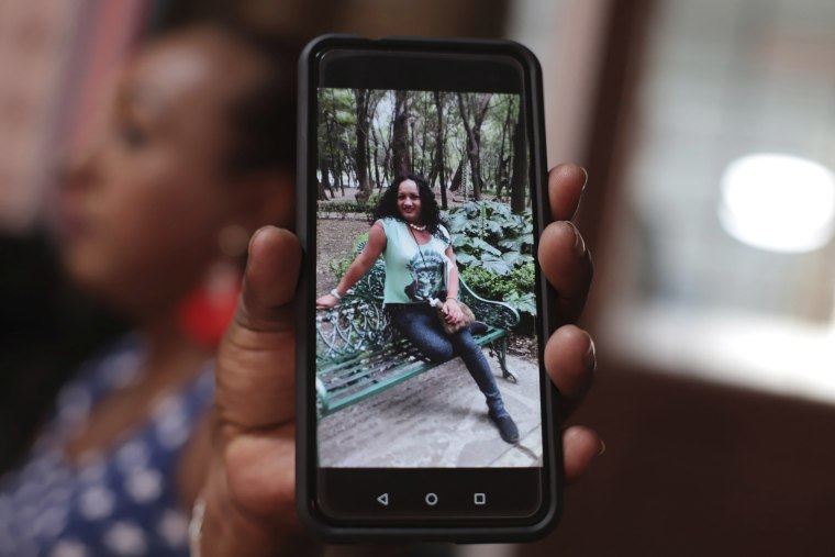 Image: Transgender woman Leticia shows a photograph of Camila Diaz, another transgender woman she met while migrating to the U.S. where they both turned themselves in to U.S. immigration authorities and were eventually deported