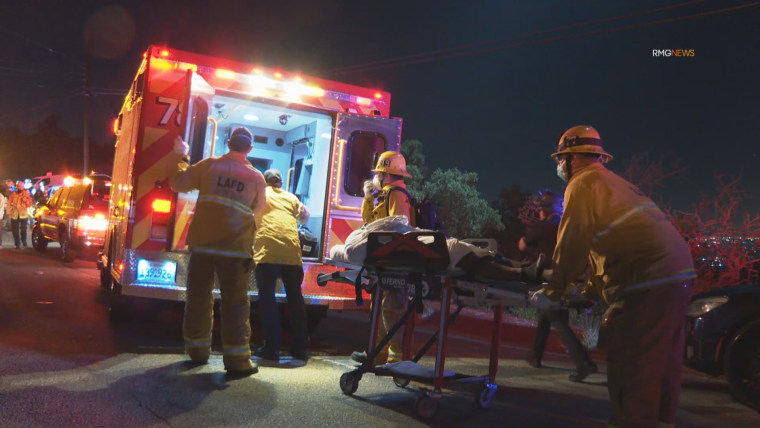 Image: Paramedics prepare to load a victim into an ambulance near a crime scene at a mansion on Mulholland Drive in Los Angeles, Calif., on Aug. 4, 2020.