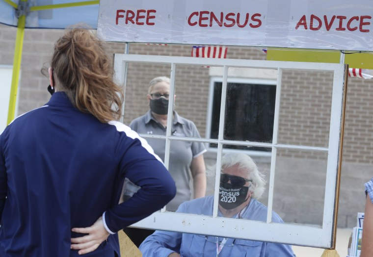 Census worker Ken Leonard wears a mask as he mans a U.S. Census walk-up counting site set up for Hunt County in Greenville, Texas, on July 31, 2020.