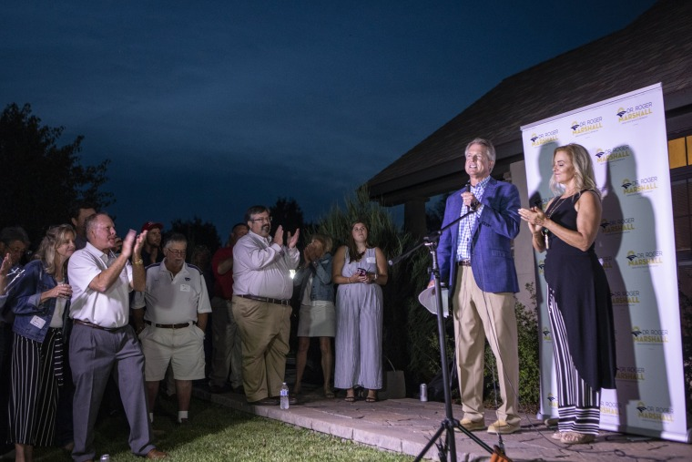 Rep. Roger Marshall, R-Kan., joined by Laina Marshall, his wife, speaks to supporters near Pawnee Rock, Kan., after defeating Kris Kobach in the Republican primary for U.S. Senate on Aug. 4, 2020.