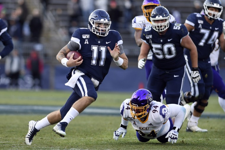 Connecticut quarterback Jack Zergiotis (11) gains yardage during the second half of an NCAA college football game against East Carolina Saturday in East Hartford, Conn., Nov. 23, 2019.