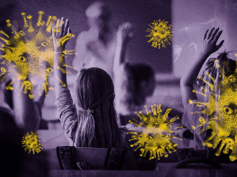 Image: Elementary school students raise their hand in a classroom as coronavirus spores loom.