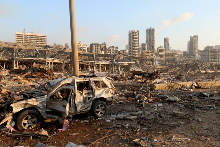 Image: A damaged vehicle is seen at the site of an explosion in Beirut