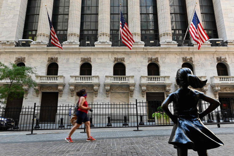 People pass by the New York Stock Exchange on Aug. 3, 2020, in New York City.