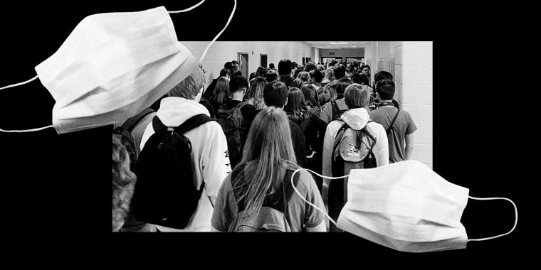 Image: Students at North Paulding High School in Dallas, Ga., crowd in a hallway on Aug. 4, 2020. The district says it is encouraging mask use, but isn't requiring it.