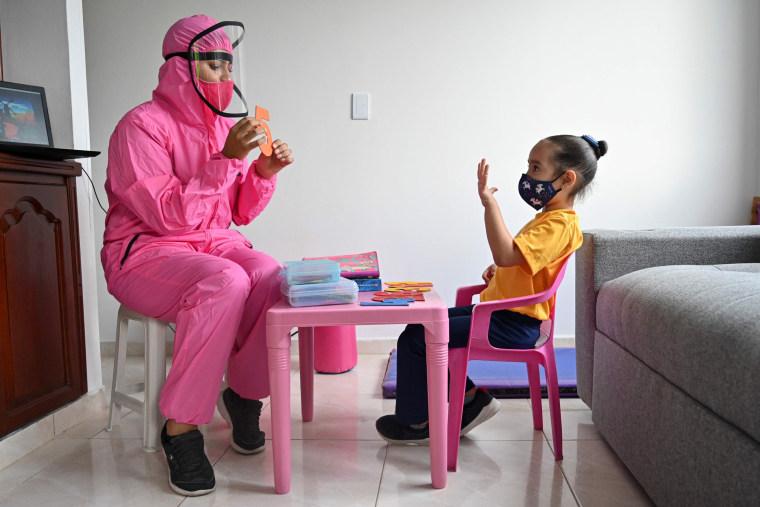 Image: TOPSHOT-COLOMBIA-HEALTH-VIRUS-EDUCATION
