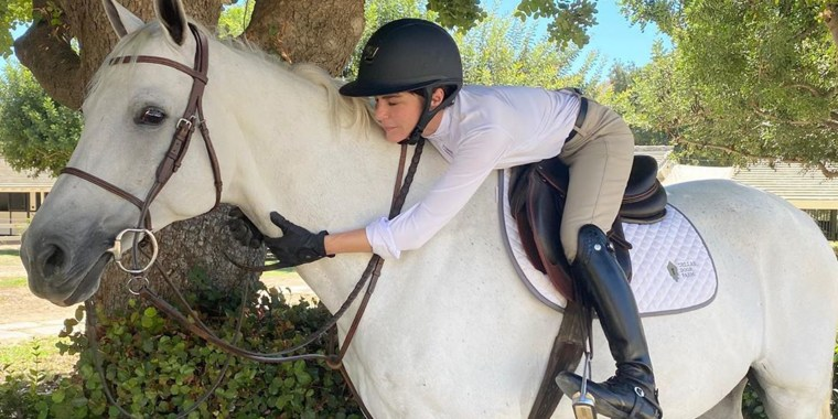 """Blair returned to the saddle to ride her """"dear horse"""" Mr. Nibbles."""