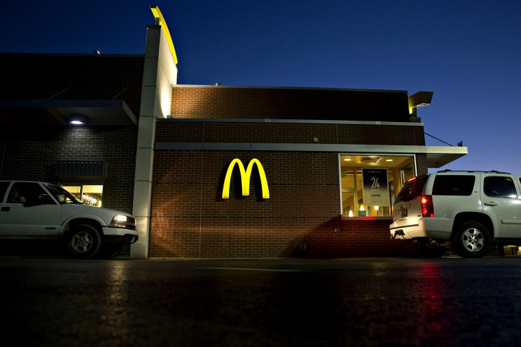 Image: Vehicles move through a drive-thru at a McDonald's in Illinois in 2015.