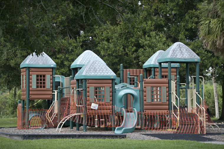 A playground is cordoned off to prevent use at a public park on Aug. 6, 2020, in Orlando, Fla.