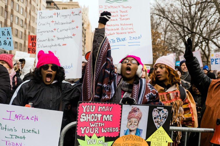 Image: Demonstrators during the fourth annual Women's March near Columbus Circle in New York