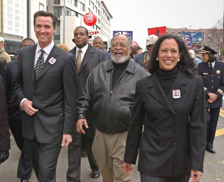 San Francisco District Attorney Kamala Harris, San Francisco Mayor Gavin Newsom, left, and Rev. Cecil Williams help lead a march in San Francisco celebrating Dr. Martin Luther King, Jr., on Jan. 19. 2004.