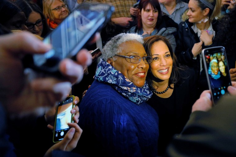 Image: Democratic 2020 U.S. presidential candidate Harris poses for a photograph with audience members in Portsmouth