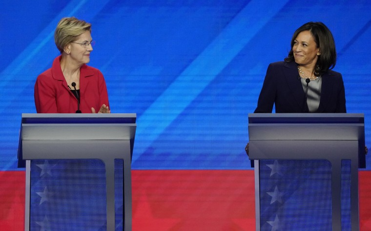 Image: Senator Elizabeth Warren and Senator Kamala Harris smile at each other during the 2020 Democratic U.S. presidential debate in Houston