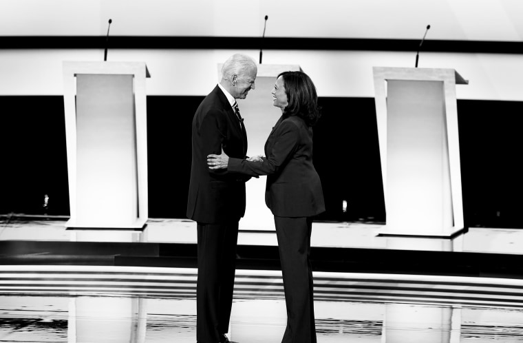 Former Vice President Joe Biden and Sen. Kamala Harris (D-Calif.) shake hands before the start of the second night of Democratic presidential debates, hosted by CNN at the Fox Theatre in Detroit, July 31, 2019. (Erin Schaff/The New York Times)
