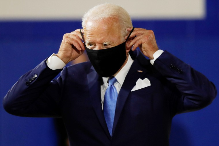 Image: Joe Biden puts on a face mask at a campaign event in Wilmington, Del., on Aug. 12, 2020.