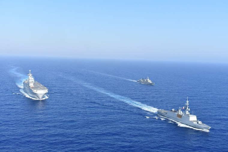 Image: Greek and French vessels sail in formation during a joint military exercise in Mediterranean sea