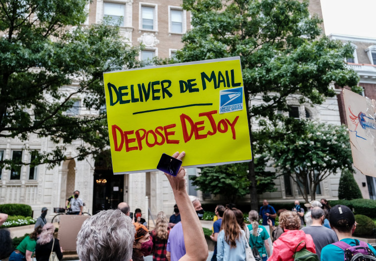 Image: Protest Held Outside Postmaster General Louis DeJoy's DC Home