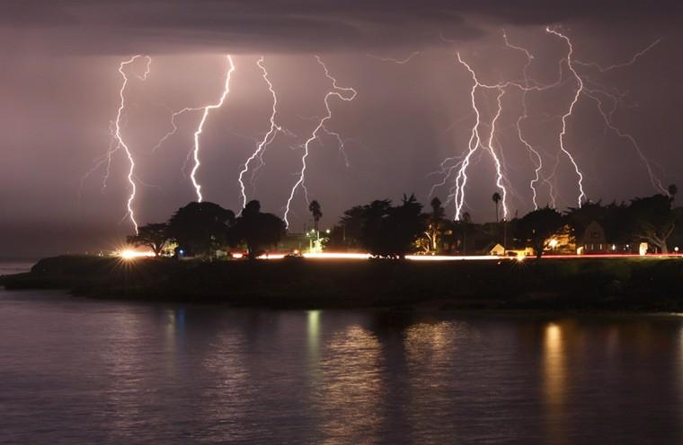 A rare lightning storm crackles over Mitchell's Cove in Santa Cruz, California, around 3 a.m. Sunday.