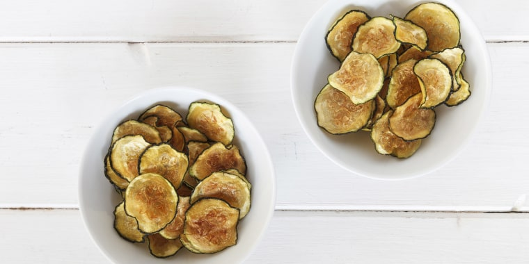 Homemade zucchini chips in bowls