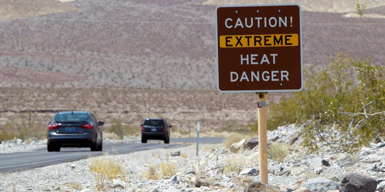 Image: FILE PHOTO: A sign warns of extreme heat as tourists enter Death Valley National Park in California